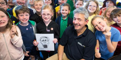 World Kids' Colouring Day winner celebrates with class and caricaturist